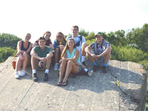 Happy students on German bunker